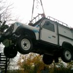 Land rover being tested for vertical lifting from roll cage mountings - in use will enable deployment via helicopter(penman-002)