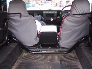 Land Rover Defender Bulkhead Removal Bar in vehicle