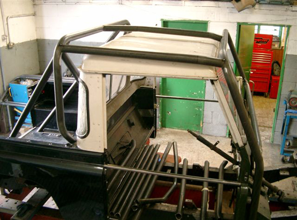 Land Rover Defender truck cab kit roll cage assembled (side view)